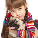child with pug