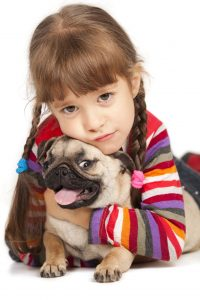child with pug