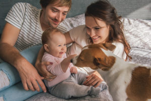 Photo of parents with baby and dog